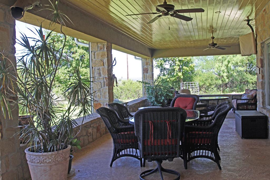 Covered porch dining and lounging area