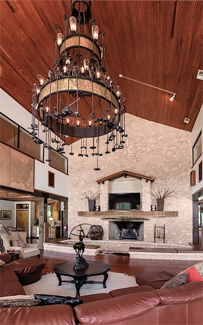 Living area with stunning Branding iron Chandelier