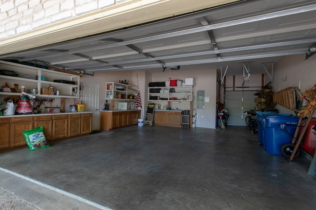 Huge Garage with Golf Cart Bay and Door